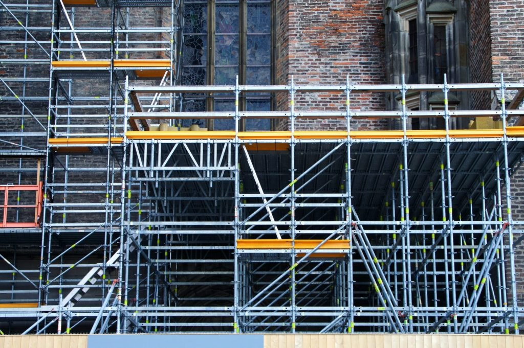 Scaffolding along brick building